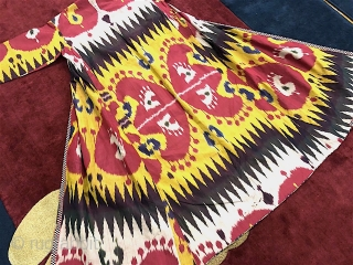 Antique 19th century Uzbek silk on silk Ikat Chapan. Beautiful natural colours and beautiful pattern(design). Good condition.