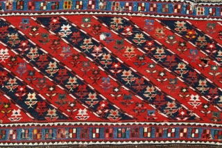 "Mogan Shahsavan Sumakh Side Panel fragment. Cm 59x106. End 19th century. Beautiful moharamat pattern with diagonal stripes, 7 indigo blue, 7 madder red, with 126 flowers and 53 ""windows""in the outer long  ..."