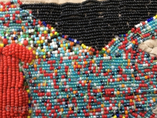 Yoruba beaded sash. Nigeria. Cm 15x100 ca. Such sashes or decorative bands were used as symbols of owner's spiritual creed and were worn in public during important ceremonies by Ifa priestesses. This  ...