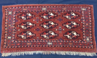 Turkmen Yomut cuval with great insect border. Cm 60x112. Late 19th century. Natural dyes. 9 gul pattern. Very precise drawing. In good condition. One restoration left corner below. Really beautifull, elegant, collectable.