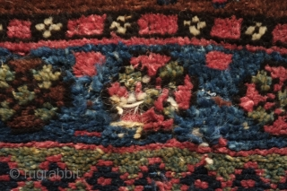 Jaff Saddle bag face, Last quarter of 19th century, All natural colors.  A wonderful archaic, hooked medallion design surrounded by floral medallions on a reddish-brown ground and with soumak (extra-weft wrapping)  ...