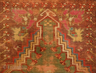 Mudjur Prayer Rug, Late 18th Century - Early 19th Century. Incredible colors. It contains a solid green field representing the heavens crested with a stunning cloud band. It is worn all over  ...