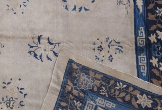 Ivory coloured Beijing rug, circa 1920. Repiled areas. Great shabby chic character full or charm. 350x270 cm.