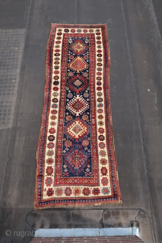 Kurdish, Caucasian,. With nice colors. Condition; b\c .Wool on wool .Some high,some low. And a raw White. Ca. 310 x 110 cm. 1900-1930 .Some old repairs in the field. Ends secured,cleaned and  ...