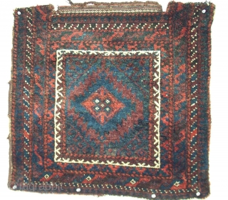 "Baluch bag face, Northeast Persia, circa 1880, size 24"" x 23"" (60 x 58 cm),these intriguingly dark, moody colors can be captivating to one who is drawn to Baluch weaving. That's the  ..."