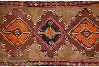 "An old Turkish flatweave,  11'2 x 5'7"" hand-knotted wool tribal kilim in rich colors, some synthetic, with bold geometric pattern.