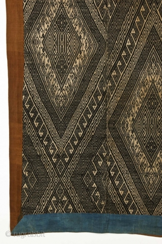 A woven indigo bed cover (Xam Nuea ceremonial blanket), natural dyed cotton, supplementary weave, c. 1900.