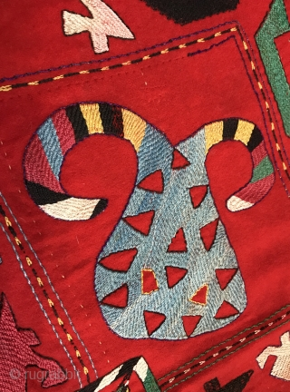 A very unique and visually dynamic  antique Uzbek Kungrat tribe embroidered ilgich square dating to late 19th century. It is silk embroidered on red bannat / wool ground. The design looks  ...