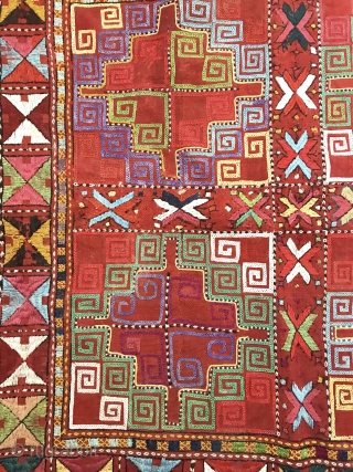 A spectacular antique Uzbek Kungrat silk embroidered on a wool kilim woven ground Iglich hanging dating to the last quarter of the 19th century. The visual dazzle of this piece is rooted  ...