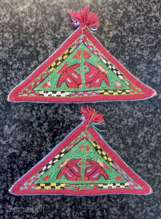 an excellent pair of Antique Ersari Turkoman / Turkmen Talismanic silk embroidery tawees / moska, dating to 19th century. Such fine triangular silk embroideries were known as moskas or tawees and to  ...