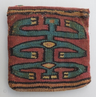 Small Pre-Columbian tapestry bag with one blue and one yellow highly stylized anthropomorphic or zoomorphic figure on each face.  Nasca Culture, a.d. 200 - a.d.600. Rare, complete, conserved and charming.   ...