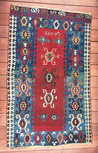 Detail of a small Western Anatolian kilim.  The colors are deeply saturated and it looks to be from the 1st half the 19th century. There is an inscription that looks like  ...