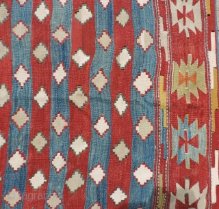 South Central Anatolian Kilim.  Unusual overall design of repeating stepped diamond forms. All dyes natural. Scattered good quality reweaving - mostly along outer edges - completes the picture.  This is  ...