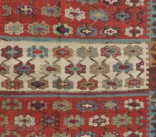 This 19th Century Reyhanli Kilim has beautiful saturated, naturally dyed colors and is in decent condition with some wear and repairs. Size: 64 x 140 inches.  As is condition - Reasonable.