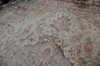 """Giant pale Amritsar carpet 600 x 552 or 19'6"""" x 16'10"""" Very worn allover,no actual holes. Fantastic 'look', with colours of cream, olive and deep magenta."""
