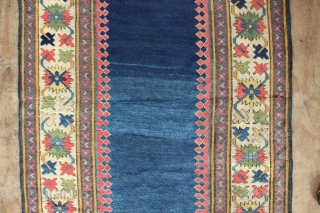 Over the years, I've owned a few of these plain field 'Met-hane' runners but this one is by far the most beautiful- and the longest! The mid to navy blue field positively  ...