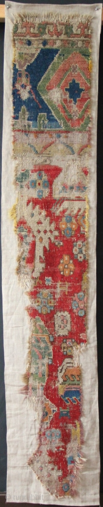 "Early Turkish rug fragment, possibly 15th century. Conserved onto linen backing. 1'4"" x 5'5"" Fantastic piece."