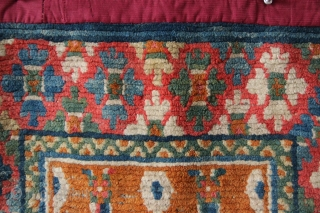 """Very pretty and unusual Tibetan sitting mat. Has an aniline red but is still an antique weave with a lot of integrity. Original edges underneath a later over-wrap. Circa 1900 2'0"""" x  ..."""