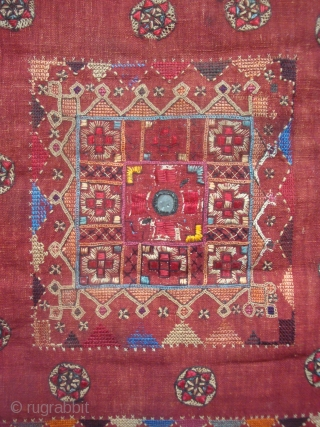 Rare and unusual old Indian textile, 38 x 63 inches, Silk and other materials embroidered on fine red cotton cloth, two pieces sewn together along the central vertical axis. Dyes appear to  ...