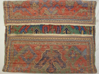 West Anatolian rug fragment. Ushak region vagireh-like rendering of an 18th century Smyrna design. Wonderful greens, reds and blues. Red wefts. Expert restorations include reweave of both ends.
