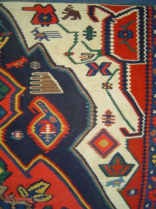 Bijar kelim, 117 x 161 cm. Tight weave, superb colors, fabulous menagerie including a pair of rhinoceros-like critters. Very good condition with original side finish and lower end kilim; small holes at  ...