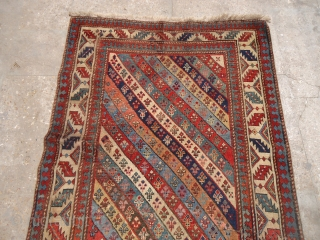 Beautiful caucasian rug with good colors design and age,old repairs done,E.mail for more info and pics.