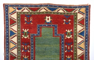 Southwest Caucasian Mid 19th Century Fahrola Prayer Rug.The empty green mihrab on a maroon field with ivory and soft yellow calyx medallions,all within a polychrome serrated leaf main border,multiple single crosspatterned minor  ...
