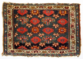 Thick pile,lustrous Kurdish wool, saturated natural dyes, single wefted. Large bagface 30x21 inches (76 x 53 cm). Notice the single row of indigo knots at top and bottom of field that let  ...