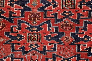 """Highly unusual sumak khorjin face, circa 1875, displaying """"Lesghi"""" medallions overall on a dramatic red ground. THe white strip is Velcro loosely stitched for mounting on the wall. It will be easily  ..."""