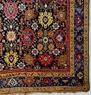 An outstanding kelleh Karabagh carpet, c 1800-25, 7.3 x 18 feet (221 X 550 cm). Sparkling natural jewel tones on a background of the deepest, almost black, indigo. Suitable for the most  ...