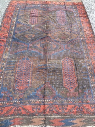 Fabulous baluch main carpet, amazing blues, wonderful red border, very fine for size, heavy, super wool, complete with kilim ends but heavily corroded black as one would expect with that age, just  ...