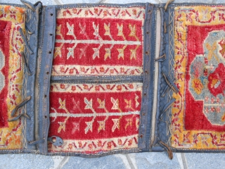 This original carpet has been knotte in ANATOLIAN. Size 133 x 51 cm. ANTIQUE MELAS saddle bag in good condition. ALL ORIGINAL. About 70/80 years old.  Has been professional washed. Other photos on  ...