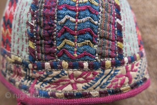 """Turkmen Tekke ethnic child hat, silk embroidery on hand loomed cotton and silk. Embroidered trim and cotton lining. Circa 1900 or earlier. Size: 5"""" – 13 cm circumference / 4"""" – 10 cm  ..."""