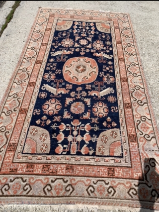 """4'4""""x 8'1"""" old Khotan with two small old and not so good reweaving jobs at one end. Otherwise, nice one for the price."""