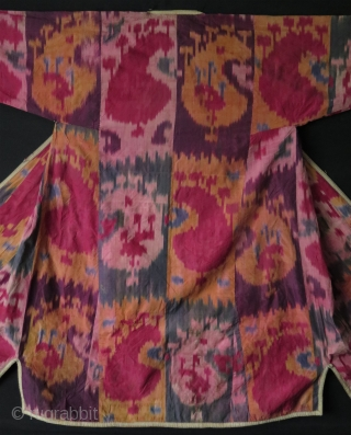 """Uzbekistan silk ikat chapan. Circa 1900's or earlier.   Some small stains, wears and little tears on it because of its age and being used.  Size: Arms spread out 65"""" - 165 cm, Height  ..."""