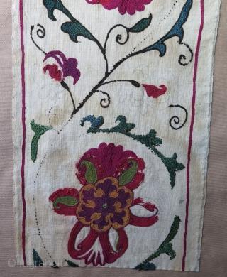 "Uzbekistan Suzani fragment from 19th century. Silk embroidery on cotton. Professionally mounted. Size: 9.8"" x 50.6"" - 25 cm x 129 cm."