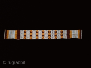 """Wool and cotton women's belt """"kourzia"""" cod. 0333. Beni Mesguilda Berber people. Western Rif. Morocco. Early 20th. century.Dimension cm. 297 x 33 ( 117"""" x 13""""). Some condition issue.  These belts were  ..."""
