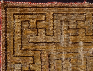 Antique khotan seating square with a rare and interesting swastika design. Probably made for the tibetan market. 19th century. 54 x 61cm.