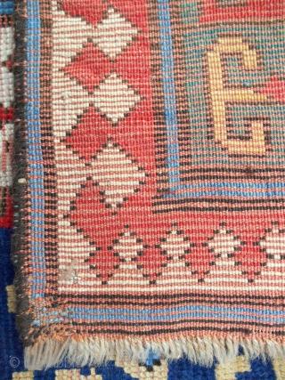 Kazak rug fragment (cut and shut). About 4 x 6 ft. Worn condition. C. 1840-60.