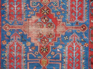 This is what I think is an antique Shikli Kazak in chic&shabby condition, as a matter of fact; very chic and very shabby. This is a rather rare item; Shikli staple motif  ...