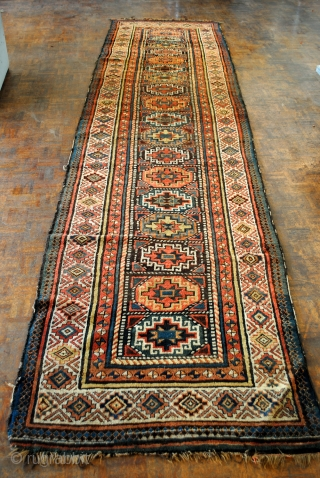 Antique Gendje or Moghan, Caucasus. 420 x 110 Cm. 14 ft.x 3.6 ft. Collectable rug, around 1850. Memling guls.  In fair condition. Wear acording to age.  Some loose wires on the side.  I  ...