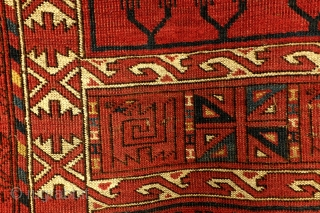 Hatchlu, Ersari Engsi, 200 x 155 Cm.   interesting details; beneath a ground panel on a light brown/red field an ornament that looks like two arms and hands.   next, a row of anchor shaped  ...
