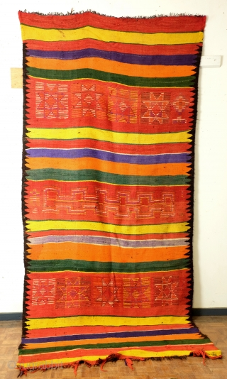 Morocco, Bedouins from the South who adapted the arabic customs. Loom woven like a kilim but different from Iranian of Turkish kilims.  Much thicker, very thick wool threads on black goat wool warp  ...