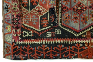 Kilim, Anatolia, fragment, as is, sewn on a protecting cloth at the back. 