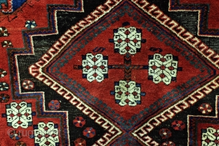 Afshar, Kirman area.  175 x 145 Cm.  5.8 ft. x 5 ft.  Wool on cotton.Thight knotted.  1920-1930.   Doj Goli i Parizi; 2 flowers from Parizi is the name of the design.  ...