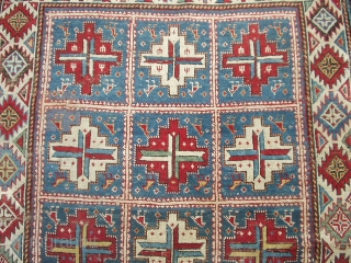 #6423 Shirvan  This Shirvan measures 4'0' X 6'0'. It has fifteen panels with red and white medallions containing cross bars of ivory/blue , ivory/red , ivory/green , blue/yellow and blue/red etc. with animal  ...