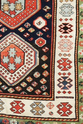 m163 Antique Kazak 154x92cm circa 1910 Lovely antique Kazak rug. This piece has a lot of character and a beautiful blue ground colour with multi medallions and a green outer border. Good  ...