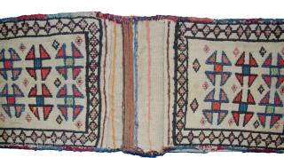 Sweet little antique Shahsavan Offering Bag from Northwest of Iran. These bags were woven by ladies who were not able to bear children. They would put 20 candle sticks in each side  ...