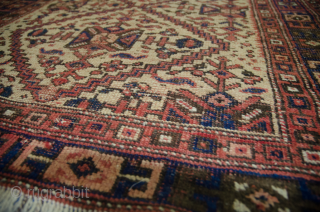 Charming antique Shiraz rug 19th Century  108x98cm. Square size on cream ground. There are two small areas where cotton is used for the pile, which is unusual.