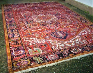 Old persian Heriz. Size: 243 x 353 cm. Good conditon.